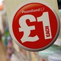 A sign is seen in a Poundland store in London.