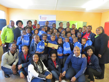 A joyful occasion - over 100 pairs of school shoes and socks were donated to the learners of Injonga Primary School.