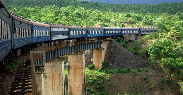 Richard Stupart via  - TAZARA Railway crossing a bridge near the Zambian-Zimbabwean border.