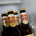 Bottles of SABMiller's flagship brew, Castle Lager, at a bar in Cape Town. Almost 120 years after first listing, its name will disappear from the JSE board this week.