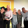 Celia Collins from Carat, handing over the 2016 MOST award for best media owner – cinema category award to the Cinemark sales team – Claire Smith, Eric Blignaut, Kim Cox, Lynne Marshall and Leslie Adams.