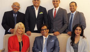 The new team announced by executive chairman, Dr Iqbal Surve, seated in the centre, to take the company forward are from top left Aziz Hartley, Yunus Kemp, Adrian Ephraim, and Gasant Abarder. Front - Adriana Senekal and Saajida Francis. Picture: Tracey Adams. Credit: Independent Media
