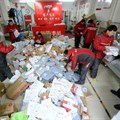 Deliverymen sort through packages of goods at a collection centre in Beijing on 9 November 2016 |