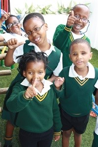 The kids from Nkosinathi Foundation of and for the Blind and Partially Sighted in Port Elizabeth celebrate their donation of R50,000, proceeds from the Algoa Cares Charity Golf Days hosted by Algoa FM in April and September 2016. They are one of the two beneficiaries of a R50,000 donation each.<br><br>From back left is Hlume B, Akhanya C, and Sipho S. From front left: Iminathi H and Morgan M.