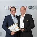 Nick Sarnadas, event director of Food and Hospitality Africa, and Gary Corin, managing director of Specialised Montgomery Exhibitions, accept the award.