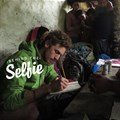 Technically not a selfie, here is Heistein in a makeshift boardroom, studying sustainable development in rural Nepal.
