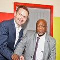 Thomas Schaefer, chairman and MD of VW Group SA and Themba Kojana, head of department for the Eastern Cape Dept of Education.
