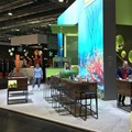 The Fairnet stand featured a large LED screen and real fish tanks as counters.