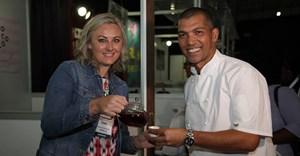 Reuben Riffel interacts with exhibitor Carmien Tea