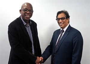Independent Media's Executive Chairman Dr Iqbal Survé, right, congratulates new Sunday Independent Editor, Steve Motale. Picture: Ian Lansberg