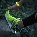 Female runner with reflective gear extension to the brand's Gear Lending offering