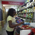 Selling Brazilian fashions, the women of Angola's 'suitcase trade' spot trends and pedal dreams