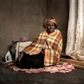 Makatleho Selibo is the widow of Mahola Selibo who worked as a team leader at President Steyn mine in Welkom. He worked underground for 33 years. He passed away in 2013 and suffered from tuberculosis and silicosis. He did not receive any compensation from the mines. Photo: Thom Pierce