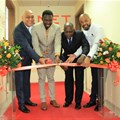 QNET Board Adviser, David Sharma; Deputy Minister for Health, Community Development, Children and Elderly, Hamisi Kigwangalla; Permanent Secretary for Trade, Industry and Investment Adelhelm Meru and QNet Country Representative for Tanzania Benjamin Mariki cut the ribbon during the opening of QNet agent office in Tanzania.