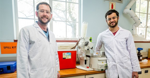 PhD chemistry students Anton Hamann (left) and Jonathan Hay with the 'Closed-Cold-Water-Recycling-System' they developed for their laboratory in the De Beers Building at Stellenbosch University. Photo: Stefan Els