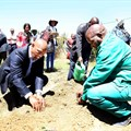 Minister Senzeni Zokwana, MEC Oupa Khoabane planting a food garden during household visits in Phuthaditjhaba