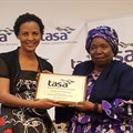 TASA President, Mary Phadi handing Dr Nkosazana Dlamini-Zuma a token of appreciation after her keynote speech.