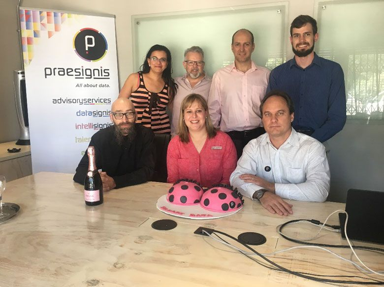 Back Row (L-R): Liesl Lodewyk – Marketing Manager, Johan Ceronio – Chairman, Gawie Erasmus – CEO, Rudie Niebuhr – System Engineer. Front Row (L-R): Jan Coetzee – System Engineer, Fébé Meyer – Marketing Manager – PinkDrive, Ruan de Beer – DM - Intellisignis
