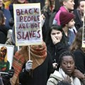 Protestors attend a demonstration against slavery in Libya, at Sergels torg in Stockholm, Sweden, on November 25, 2017 |