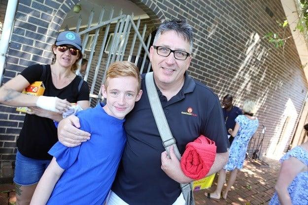 East Coast Radio Breakfast's Darren Maule with Northlands Primary's Josh Crocker