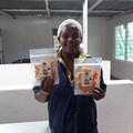 Sweet n Dried founder Mercy Mwende at the processing factory with dried mangoes. (Image Supplied)