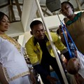 A nurse weighs a baby at a clinic in Accra, Ghana. Photo: Kate Holt/MCSP