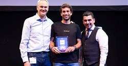 Oradian co-founder Julian Oehrlein on stage at the European FinTech event in Brussels accepting the award for Europe's Most Innovative Banking Software.