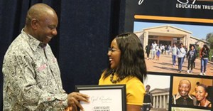 President Cyril Ramaphosa (left), awarding Senzekile Maseko (right) with the CRET Top Achiever Award at the CRET Student Awards.