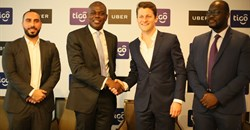 Tigo managing director, Simon Karikari, (second left), and the general manager of Uber East Africa, Loic Amado, shake hands after announcing the partnership between Tigo and Uber Tanzania in Dar es Salaam. Others are: Uber country manager, Alfred Msemo and Tigo's head of mobile financial services, Hussein Sayed. Source: Tigo.