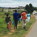 People stroll along Moshoeshoe Street in Emfuleni. Photo: Darya Maslova
