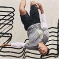 H&M's New Routine sportswear campaign featuring graffiti artist Revok's unauthorised artwork in the background. H&M