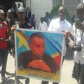Congolese journalists stand in solidarity with imprisoned journalist Eliezer Ntambwe in front of the DRC's Prosecutor General's Office in Kinshasa on April 3, 2018.