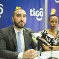 Tigo Tanzania's chief officer for mobile financial services, Hussein Sayed (left), briefs journalists on the GSMA Mobile Money Certification. Flanking him is Tigo's corporate communications manager, Woinde Shisael (right).