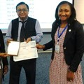 Peaceful Mathebula (left) and Tomi Oshokoya (right) receive certificates for their presentation from Professor DK Banwet (middle) in Thailand
