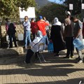 People queueing for drinking water at the Newlands spring, Cape Town. (Photo: Ralph Tyrrell)