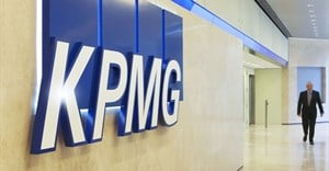KPMG to cut 400 jobs in salvage operation