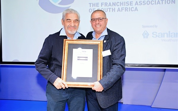 Fasa bestowed the prestigious Hall of Fame award to Ian Fuhr (left), entrepreneur and founder of the Sorbet brand of grooming stores.