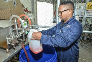 LBN CEO Lazola Nxele, an entrant in the Eskom Business Investment Competition, packaging dishwasher soap which he manufactures.