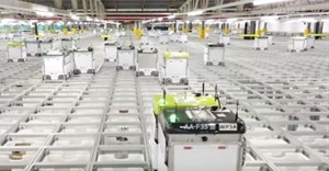 Watch robots pack groceries in Ocado's automated warehouse