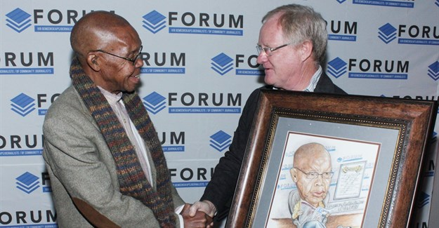 The Forum of Community Journalists (FCJ) bestowed honorary life membership of the FCJ on Joe Thloloe, chairperson of the judging panel of the FCJ Excellence Awards. Here Thloloe receives a gift from Hugo Redelinghuys (executive director of the FCJ) to mark the occasion.