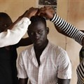 An actor and film crew prepare before a rehearsal in the office of Junub Open Space, a grassroots group that promotes social change in Juba, South Sudan. Credit: Thomson Reuters Foundation/ShanShan Chen.
