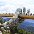 Giant hands lift new Vietnamese floating bridge