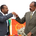 Ethiopian Prime Minister Abiy Ahmed, left, and Eritrean President Isaias Afwerki celebrate the reopening of the Embassy of Eritrea in Addis Ababa on July 16. An Ethiopian news crew was attacked and their driver killed while traveling to the capital to cover the visit. Credit: AFP/Michael Tewelde.