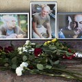 Flowers and photos of Aleksandr Rastorguyev, Kirill Radchenko, and Orkhan Dzhemal, are left at the journalist union building in Moscow. The Russian journalists were killed while on assignment in the Central African Republic. Credit: AP/Pavel Golovkin/CPJ.