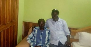 Nigerian journalist Jones Abiri (left) and Alagoa Morris (right) in Abuja after Abiri's release from detention on August 15, 2018.