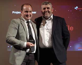 (From left) Kallie van den Berg, Director Coastal at MakeMeMobile, receiving the Honeywell Project of the Year award from Darrel Williams, Sales Director EMEA Honeywell Workflow Solutions, at an evening banquet in Madrid.