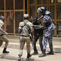 Security forces detain a protester in Kampala on August 20. Security personnel beat and detained at least four journalists who were covering unrest in Uganda's capital. Credit: AP/Ronald Kabuubi/CPJ.