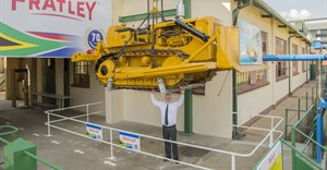 Pratley replicates its famous suspended bulldozer stunt