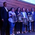 The 2018 Standard Bank Sikuvile Journalism Awards' investigative journalism and story of the year winners on stage.