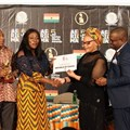 Matlou Tsotetsi, director, Brand Communication, presenting the certificate of AFRIMA Host Country to Ghana Minister Catherine Afeku, Ministry of Tourism, Arts & Culture.